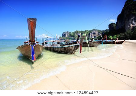 Railay Beach, Tropical beach traditional long tail boat andaman sea thailand