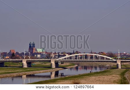 Bridge on the River Warta and the towers of the cathedral in Poznan