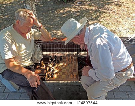 VORONEZH, RUSSIA - August 22, 2015: Two players senior adult men are contemplating a move in chess. August 22, 2015 in Voronezh, Russia