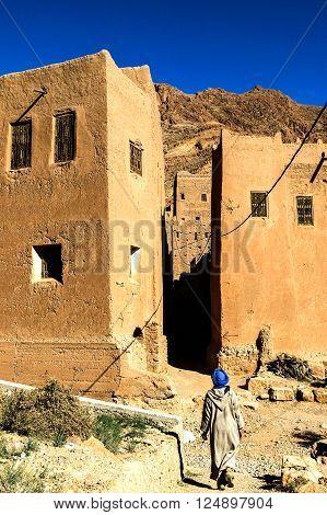Bereber man walking throught the morrocan village