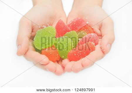 Jelly sweet in the hand, flavor fruit, candy dessert colorful on sugar.
