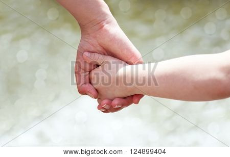 Hands of the mother and the child