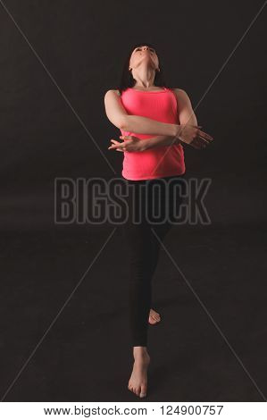 young female dancing jazz over black background