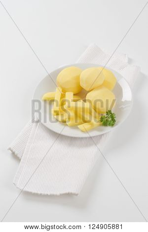 plate of raw potatoes and french fries on white place mat