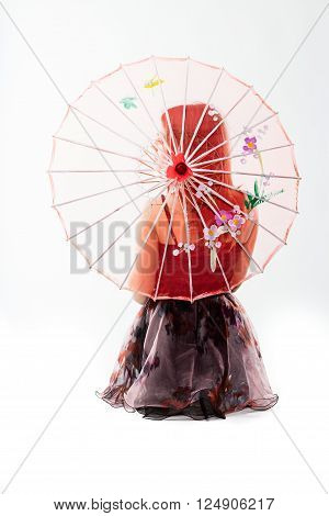 young dancer behind a semi-transparent red chinese umbrella
