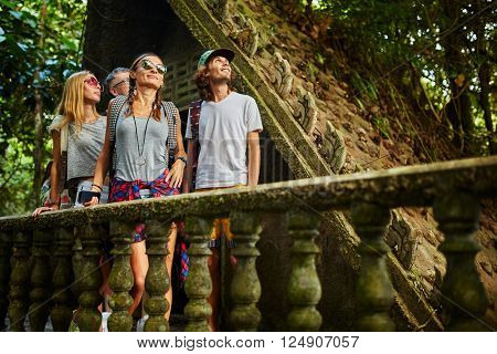 tourist exploring ancient jungle ruins in tropical rain forest on thailand adventure