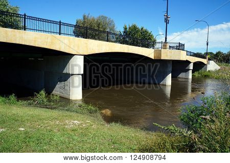 PLAINFIELD, ILLINOIS / UNITED STATES - SEPTEMBER 20, 2015: The DuPage River flows under a bridge in downtown Plainfield.