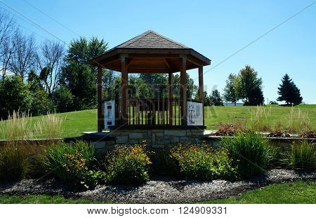 PLAINFIELD, ILLINOIS / UNITED STATES - SEPTEMBER 20, 2015: The Illinois Lincoln Highway Commission provides a gazebo in downtown Plainfield.