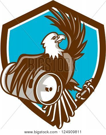 Illustration of an american bald eagle carrying beer keg viewed from the side set inside shield crest on isolated background done in retro style.