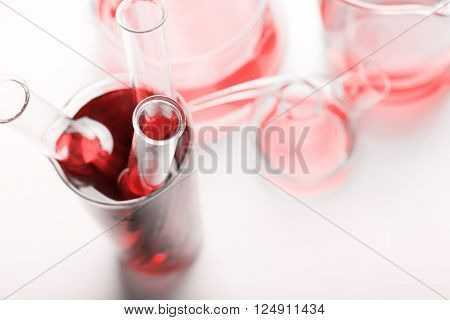 Three test tubes with blood on white background