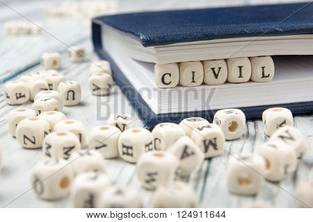 CIVIL word written on wood block. Wooden ABC.