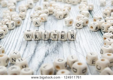writer word written on wood block. wooden abc.