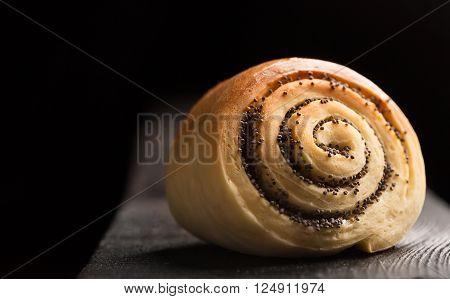 Delicious twisted baked buns with poppy seeds