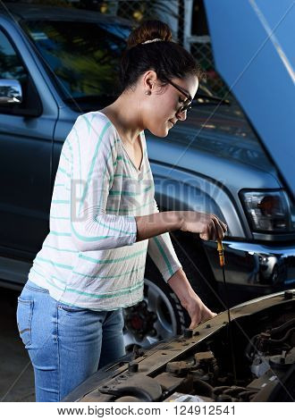 Young Woman Check Oil