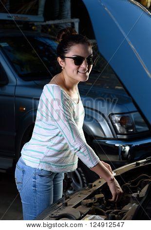 Smiling Woman Check Car Oil