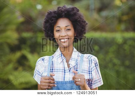 Smiling woman in the garden looking at the camera