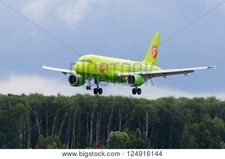 DOMODEDOVO RUSSIA - JULY 20: Aircraft operated by S7 Airlines landing at Moscow airport in Domodedovo on July 20 2013. The company in its fleet has 20 aircraft Airbus-A319