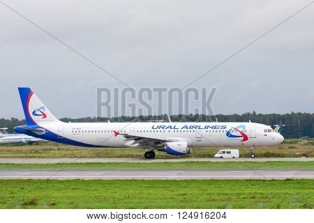 MOSCOW, RUSSIA - JULY 20: Aircraft operated by Ural Airlines ready to take off at Moscow airport in Domodedovo on July 20 2013. The company in its fleet has 10 aircraft Airbus-A321