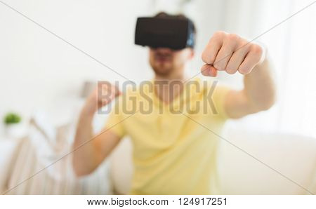 3d technology, virtual reality, gaming, entertainment and people concept - close up of young man with virtual reality headset or 3d glasses playing combat game and fighting