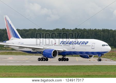 MOSCOW, RUSSIA - JULY 20: Aircraft operated by Transaero Airlines ready to take off at Moscow airport in Domodedovo on July 20 2013. The company in its fleet has 9 aircraft Boeing-777-200ER