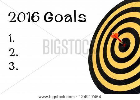 Words 2016 goals and dart target with arrow on bullseye, Goal target success business investment financial strategy concept, abstract background
