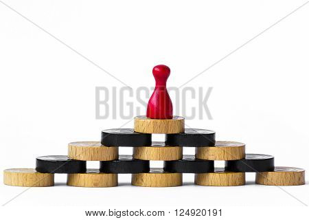 Red playing pawn standing top of the pyramid, isolated on white background.