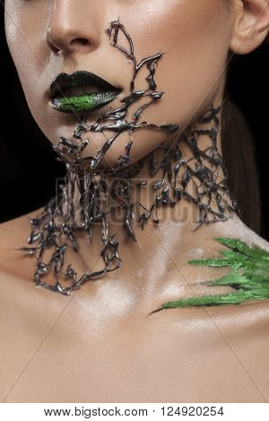 Girl with black fashion mesh arround neck and green make up on black lips. Fashion on stage make up. Artistic make up. Studio