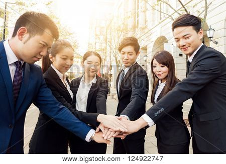 Business team joinging hands together