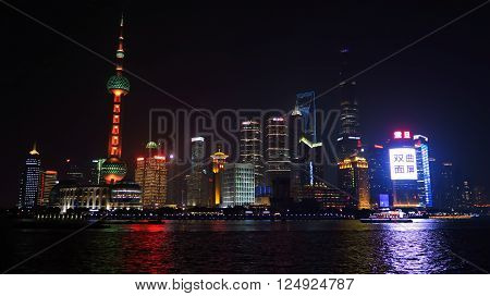 SHANGHAI CHINA - JANUARY 19 2016: Shanghai Skyline at night Pudong Huangpu River Oriental Pearl Tower Jin Mao Tower Shanghai International Finance Centre Shanghai World Financial Center