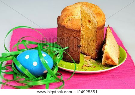Easter eggs and cake on the bright background. shallow depth of field