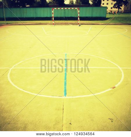 Empty Outdoor Handball Playground, Plastic Light Green Surface On Ground And White Blue Bounds Lines