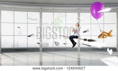 Woman flying on besom