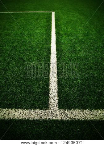 Cross Of Painted White Lines On Outdoor  Football Grass. Artificial Green Turf Texture.