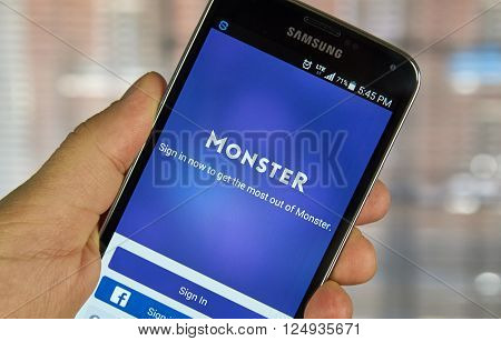 MONTREAL CANADA - APRIL 7 2016 : Monster job search application on a cell phone. Monster is a global online employment solution for people seeking jobs.