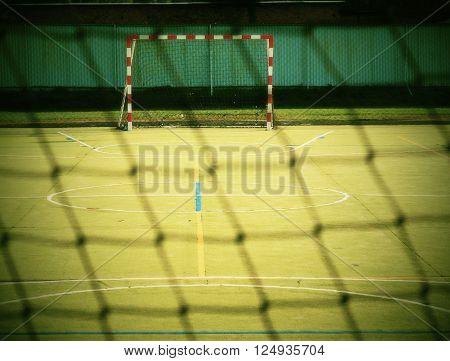 Empty Gate. Outdoor Football Or Handball Playground, Plastic Light Green Surface On Ground