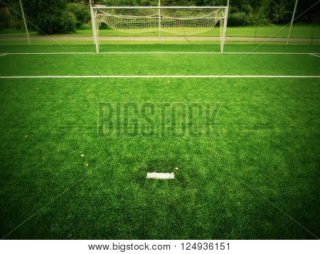 Football Playground View Of Grass Field, Gate At The End. Detail Of A Corner In A Soccer Field. Plas