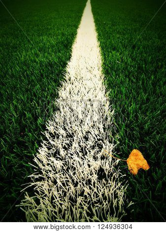 White line marks painted on artificial green turf background. Winter football playground with plastic grass. ** Note: Visible grain at 100%, best at smaller sizes