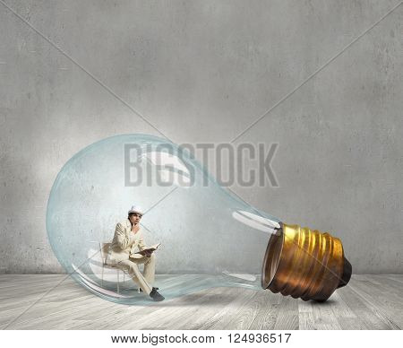 Man in electric bulb