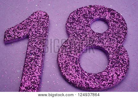 Number eighteen purple color over a purple background. Anniversary. Horizontal