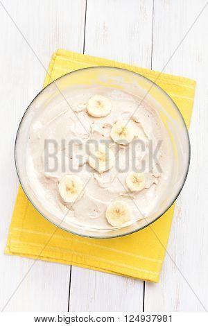 Homemade banana ice cream in glass bowl top view