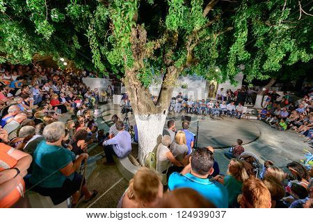 KYTHNOS GREECE - AUGUST 14 2014: People gathered to listen to traditional and folk music from the elders in the town of Dryopida