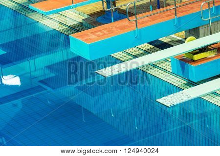 Several diving boards in the swimming pool.