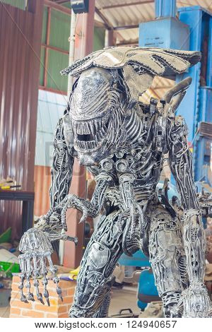 ANG THONG, THAILAND - APRIL 3 :  the Alien character made of remnant of iron on April 3, 2016 in Ang Thong, Thailand