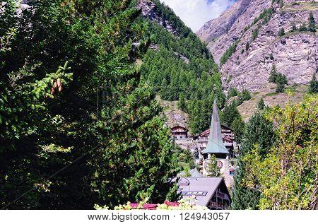 ZERMATT, SWITZERLAND - AUGUST 31, 2014: Church of Saint Mauritius on August 31, 2014 in Zermatt, Switzerland. Zermatt is a Mountain Resort Town in Southern Switzerland.