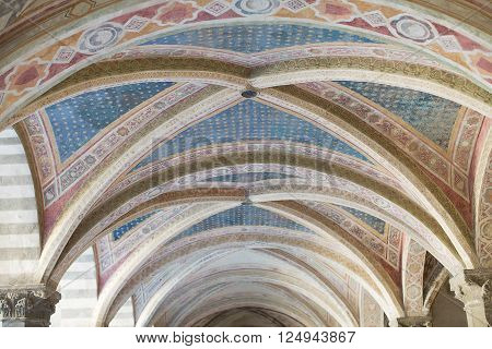 Florence, Italy-June 2, 2015.Architecture and decoration detail of the cloisters of the Basilica of Santa Maria Novella, situated just across from the main railway station which shares its name.