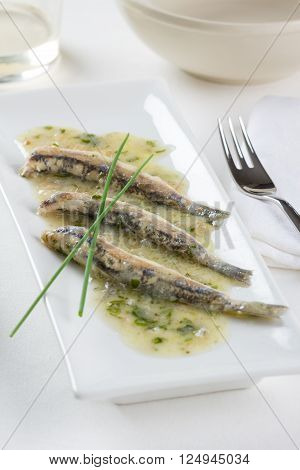 Marinated anchovies Spanish style with garlic, parsley and olive oil
