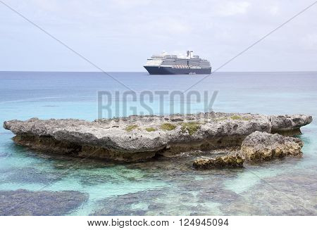 The view of a cruise ship from Tadine beach (New Caledonia).