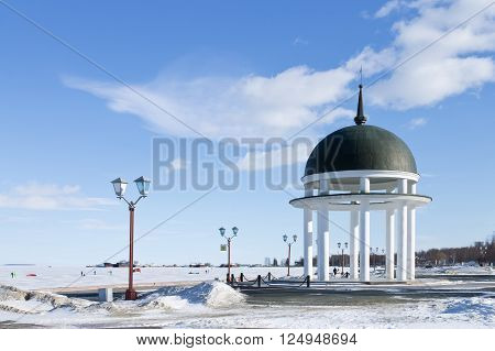 Rotunda on winter embankment on the Onego lake in Petrozavodsk, Russia