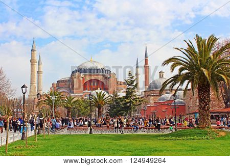 ISTANBUL, TURKEY - MARCH 30, 2013: View of Saint Sophia mosque and the area with tourists citizens and street sellers, Istanbul, Turkey