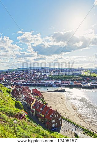 Coast of North Sea in Whitby in North Yorkshire in England. Whitby is a seaside port and town on the coast of the river Esk.